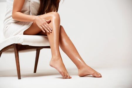 naked legs: Long Woman Legs . Beautiful Woman Cares About Legs. Depilation Stock Photo