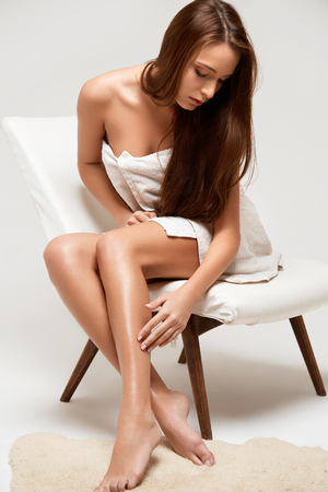 young girl nude: Long Woman Legs . Beautiful Woman Cares About Legs. Depilation Stock Photo