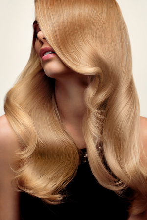 blond hair: Blond hair. Portrait of beautiful Blonde with Long Wavy Hair. High quality image.