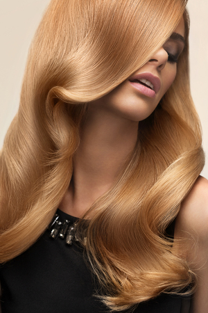 hair studio: Blond hair. Portrait of beautiful Blonde with Long Wavy Hair. High quality image.