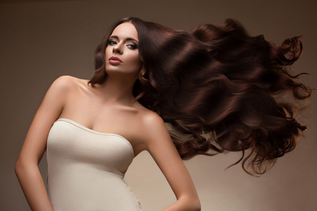 Hair. Portrait of Beautiful Woman with Long flying Hair. High quality image.