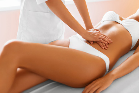 the caucasian beauty: Spa Treatment. Body Care. Massage On Relaxed Beautiful Young Caucasian Womans Body In The Spa Salon. Body Care, Skin Care, Wellness, Wellbeing, Beauty Treatment Concept.