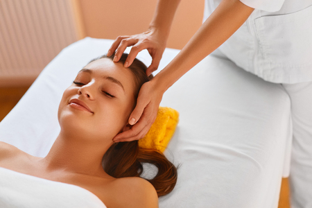 procedures: Face Skin. Pretty Young Healthy Woman Receiving Facial Spa Treatment. Masseur Doing Face Massage With  Rejuvenating, Moisturizing, Refreshing, Anti-aging Cosmetics In Renew Beauty Cosmetology Esthetics Medical Spa Salon Or Clinic. Skin Care, Recreational,
