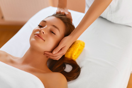 rejuvenating: Face Skin. Pretty Young Healthy Woman Receiving Facial Spa Treatment. Masseur Doing Face Massage With  Rejuvenating, Moisturizing, Refreshing, Anti-aging Cosmetics In Renew Beauty Cosmetology Esthetics Medical Spa Salon Or Clinic. Skin Care, Recreational,