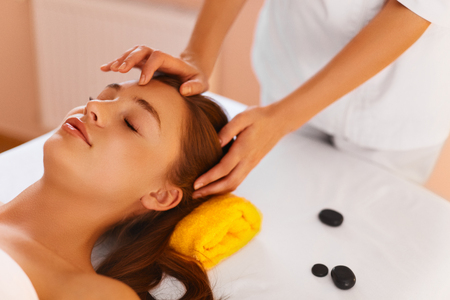 esthetics: Face Care. Skin Treatment, Recreational Procedure. Portrait Of Beautiful Healthy Young Woman During Facial Massage With  Rejuvenating, Moisturizing, Refreshing, Regenerative, Anti-aging Cream In Renew Beauty Cosmetology Esthetics Medical Spa Salon Or Clin