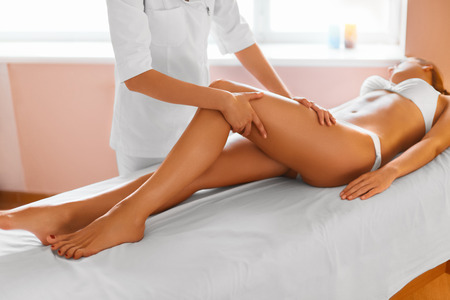 beauty therapist: Woman Legs. Body Care. Beautiful Woman Getting Leg Massage Treatment In Spa Salon. Skin Care, Wellbeing, Wellness, Lifestyle, Relaxing Procedure. Stock Photo