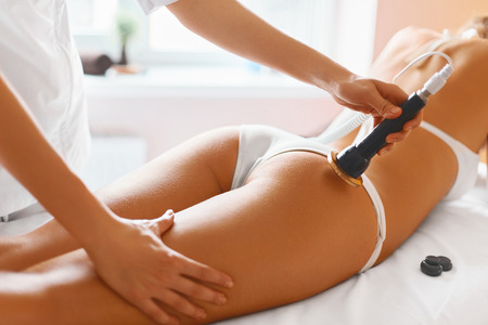 therapy equipment: Body Care. Spa Treatment. Ultrasound Cavitation Body Contouring Treatment. Woman Getting Anti-cellulite And Anti-fat Therapy In Beauty Salon.