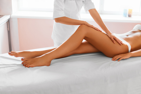 beauty therapist: Woman Legs. Body Care. Beautiful Woman Getting Leg Massage Treatment In Spa Salon. Skin Care, Wellbeing, Wellness, Lifestyle, Relaxing Procedure. Stock Photo