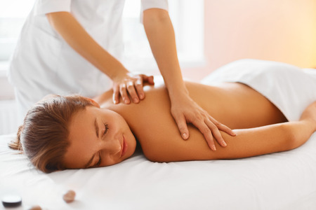 cosmetologies: Spa Woman. Female Enjoying Relaxing Back Massage In Cosmetology Spa Centre. Body Care, Skin Care, Wellness, Wellbeing, Beauty Treatment Concept.