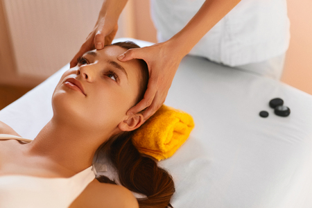 esthetics: Face Spa. Close Up Portrait Of Beautiful Healthy Young Woman During Facial Massage With Rejuvenating, Moisturizing, Refreshing, Regenerative, Anti-aging Cream In  Beauty Cosmetology Esthetics Medical Spa Salon Or Clinic. Face Treatment, Aromatherapy, Skin Stock Photo