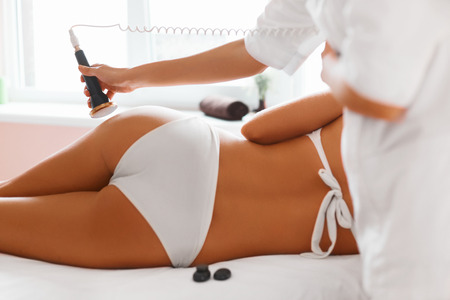 human body: Body Care. Ultrasound Cavitation Body Contouring Treatment. Woman Getting Anti-cellulite And Anti-fat Therapy In Beauty Salon. Spa Treatment. Stock Photo