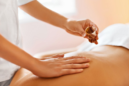 Body Massage. Spa Therapy. Masseur Doing Massage On Beautiful Young Healthy Caucasian Woman Body In  Spa Salon. Beauty Treatment Concept. Skincare, Wellbeing, Wellness, Lifestyle. Stock Photo