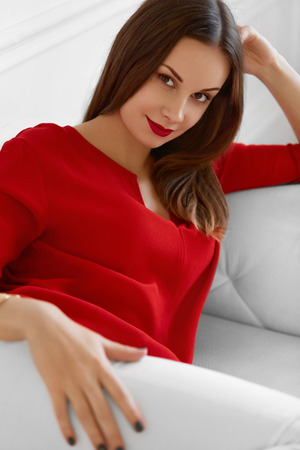 confident woman: Beautiful Woman Portrait. Happy Fashionable Elegant Successful Office Business Woman Relaxing On Sofa, Looking Confident And Smiling. Wellbeing, Luxury Lifestyle.