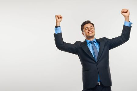 arms up: Business Man Celebrating Success against White Background