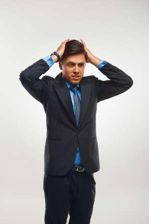 against white: Stressed Businessman against white background Stock Photo