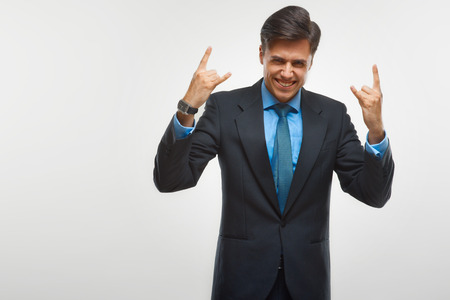 success man: Excited business man celebrating success isolated on white background Stock Photo