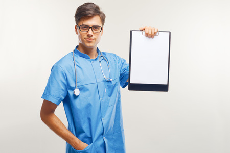 medical occupation: Doctor Showing Clipboard Over White Background Stock Photo