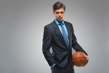man business: Businessman with ball against gray background Stock Photo