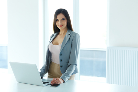 happy worker: Shot of a Businesswoman at Work in an Office