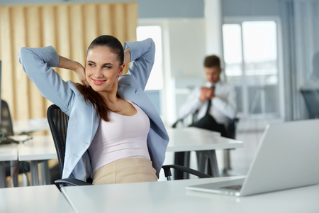 woman relax: Relaxed Young Businesswoman Feeling Positive