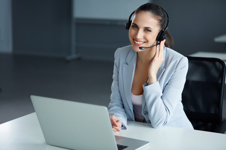 operator: Call Center Operator Sitting Infront of Her Computer