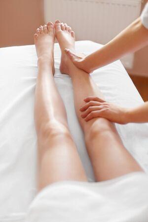 leg: Young Woman Receiving Leg Massage at Spa Center. Body Care