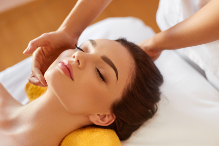 salon and spa: Spa Woman. Beautiful Young Woman Getting a Face Treatment at Beauty Salon. Face Massage
