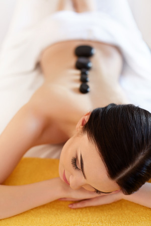 hot rock therapy: Spa Stone Massage. Young Woman Have Hot Stone Massage Treatments. Spa Hot Stones