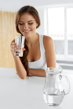 clear water: Beauty, Diet Concept. Happy Smiling Woman Drinking Fresh Crystal Clear Water From A Glass. Healthcare. Healthy Lifestyle And Eating. Health, Dieting, Fitness Concept. Drinks