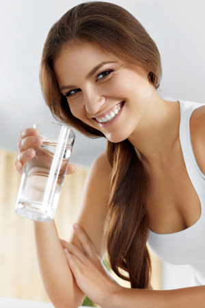 water sport: Health, Beauty, Diet Concept. Portrait Of Happy Smiling Young Woman Drinking Refreshing Water In The Morning. Healthcare. Drinks. Healthy Eating. Healthy Lifestyle. Hydratation.
