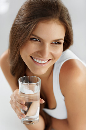 healthcare portrait: Healthy Lifestyle. Close-up Portrait Of Young Woman Drinking Refreshing Pure Water From Glass. Healthcare. Drinks. Water.  Health, Beauty, Diet Concept.
