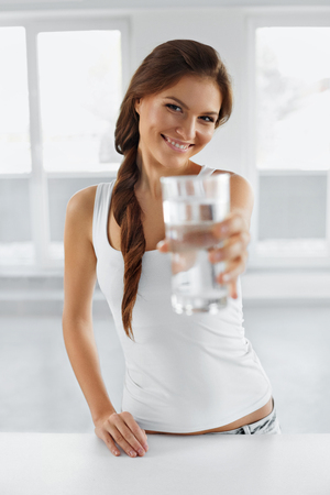 Diet Concept. Happy Healthy Young Woman With Glass Of Fresh Water. Healthcare. Drinks. Healthy Lifestyle And Eating. Healthy, Beauty, Dieting, Fitness Concept.