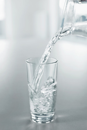 thirstiness: Drinking Water. Pour Fresh Pure Water From Pitcher Into A Glass. Health, Diet, Lose Weight, Hydratation Concept. Healthy Lifestyle. Healthcare. Drinks.