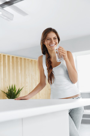 water concept: Drink Water. Happy Beautiful Woman Drinking Fresh Pure Water. Healthcare. Drinks. Healthy Eating. Healthy Lifestyle. Health, Beauty, Diet Concept.