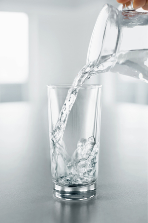 thirstiness: Drink Water. Pouring Fresh Crystal Clear Drinking Water From Pitcher Into A Glass. Health And Diet Concept. Healthy Lifestyle. Healthcare. Hydratation.
