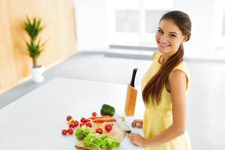 woman knife: Healthy Food. Happy Smiling Young Woman Preparing Vegetarian Dinner, Cutting Vegetables, Cooking Salad With Knife In Kitchen. Healthy Lifestyle And Eating. Diet, Dieting Concept. Nutrition