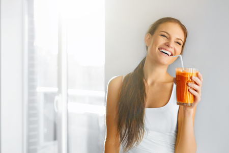 Healthy Lifestyle. Closeup Of Beautiful Smiling Vegetarian Woman Drinking Fresh Raw Detox Vegetable Juice. Healthy Food Eating, Diet And Lifestyle Concept. Drinks. Beauty Concept. Stock Photo