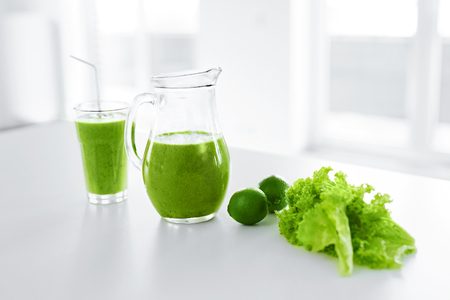 Green Juice. Healthy Eating. Juicing Cold Pressed Vegetable Smoothie For A Detox Diet. Healthy Drink, Meal, Food, Diet Concept. Vitamins. Fitness And Healthy Lifestyle Concept. Stock Photo