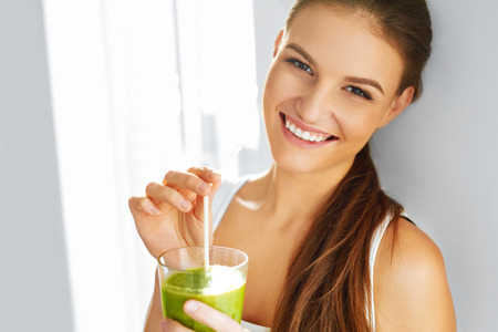juice fresh vegetables: Healthy Food Eating. Happy Beautiful Smiling Woman Drinking Green Detox Vegetable Smoothie. Diet. Healthy Lifestyle, Vegetarian Meal. Drink Juice. Health Care And Beauty Concept.