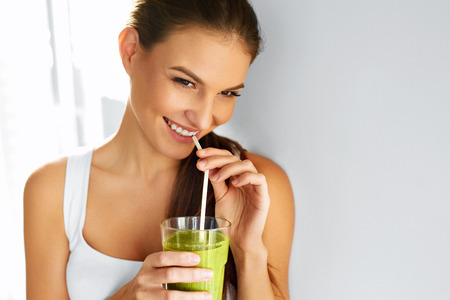 cleanse: Diet. Healthy Eating Woman Drinking Fresh Raw Green Detox Vegetable Juice. Healthy Lifestyle, Vegetarian Food And Meal. Drink Smoothie. Nutrition Concept. Stock Photo