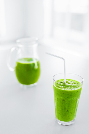 detoxing: Green Juice. Healthy Eating. Juicing Cold Pressed Vegetable Smoothie For A Detox Diet. Healthy Drink, Meal, Food, Diet Concept. Vitamins. Fitness And Healthy Lifestyle Concept. Stock Photo