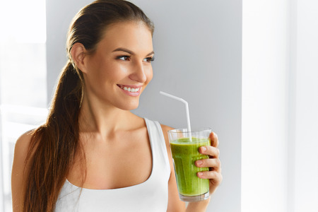 detox: Diet. Healthy Eating Woman Drinking Fresh Raw Green Detox Vegetable Juice. Healthy Lifestyle, Vegetarian Food And Meal. Drink Smoothie. Nutrition Concept. Stock Photo