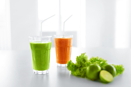 detoxing: Fresh Juice. Green And Orange Organic Vegetable Blended Smoothie In The Glass. Detox Diet. Healthy Drink, Eating, Food. Vitamins. Healthy Lifestyle Concept.