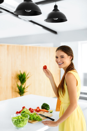 preparation: Healthy Lifestyle. Closeup Woman Cutting Fresh Organic Vegetables On A Wooden Board In Kitchens. Salad, Food Preparation. Healthy Eating, Diet Concept. Nutrition. Stock Photo