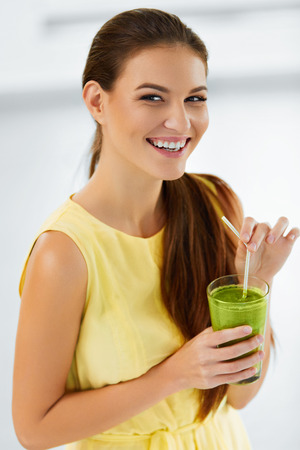 Healthy Diet. Closeup Of Beautiful Smiling Woman Drinking Green Detox Vegetable Juice. Healthy Lifestyle And Eating. Vegetarian Food. Drink Smoothie. Health Care And Beauty Concept. Nutrition