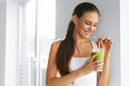 human energy: Diet. Healthy Eating Woman Drinking Fresh Raw Green Detox Vegetable Juice. Healthy Lifestyle, Vegetarian Food And Meal. Drink Smoothie. Nutrition Concept. Stock Photo