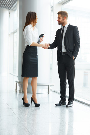 executive women: Business People. Successful Business Partner Shaking Hands in the office