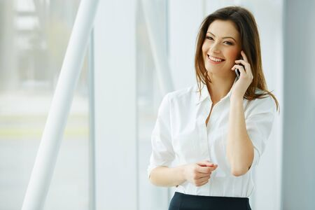 telephone call: Young businesswoman talking on the mobile phone