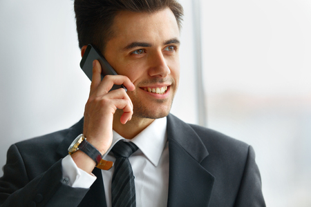 young businessman: Businessman Talking on the Phone and Smiling