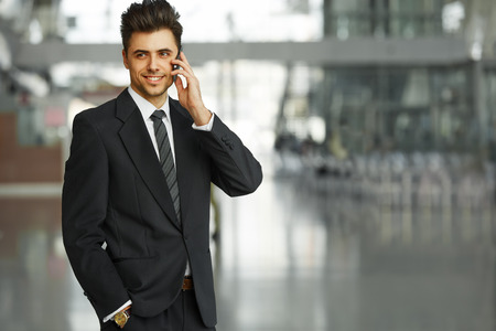 mobile phones: Businessman Talking on the Phone and Smiling